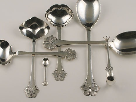 """Butterfly"" serving items in 830 grade silver"