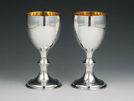 A pair of sterling silver wine goblets