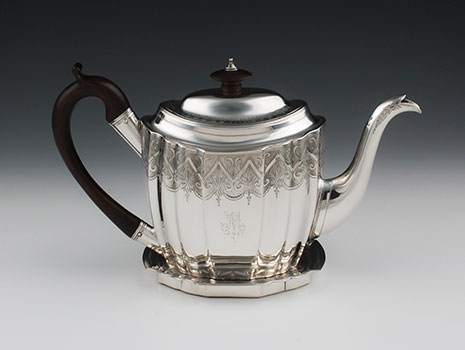 A George III sterling silver teapot on stand